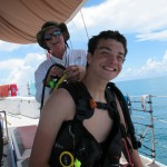 After the dive, Denny helps John out of his BCD.