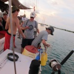 The yellow bucket is what we hold the fish in until time to rig the sharkline.  It hangs over the side so the fish get enough water circulation for oxygen to keep them alive.