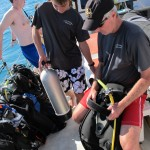 Setting bcd up on a freshly filled scuba cylinder.