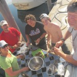 We take advantage of the table on the dock to clean the lobsters.  Many hands make for lighter work.
