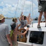 Hoisting the mainsail.